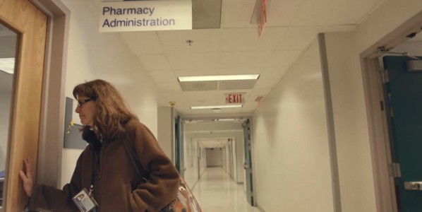 woman walking into hospital pharmacy