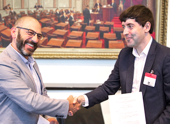 USP CEO Dr. Ronald T. Piervincenzi and BP's group manager James Pound shake hands after signing an MOU to formalize the long-standing partnership between the two pharmacopeias.