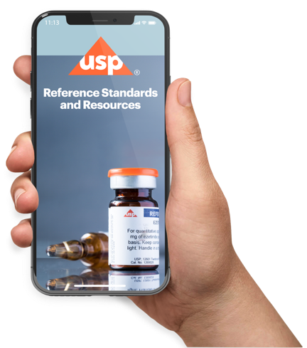 Hand holding a mobile phone using the USP Reference Standards Mobile App