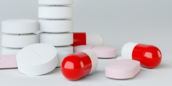stack of tablets and pills