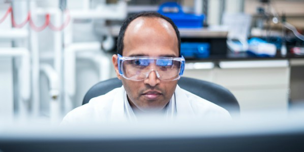 man in lab at computer
