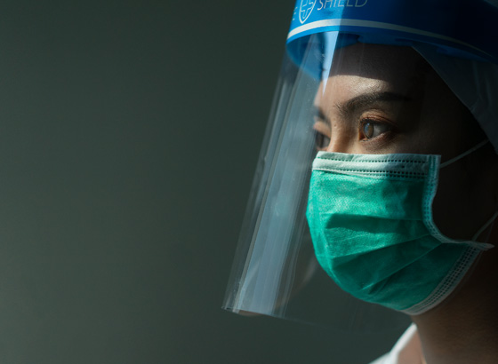 frontline healthcare worker in face shield
